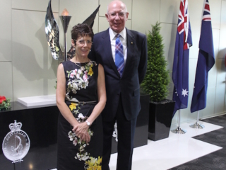 His Excellency and Mrs Hurley in front of the Eternal Flame Memorial at the Services Club